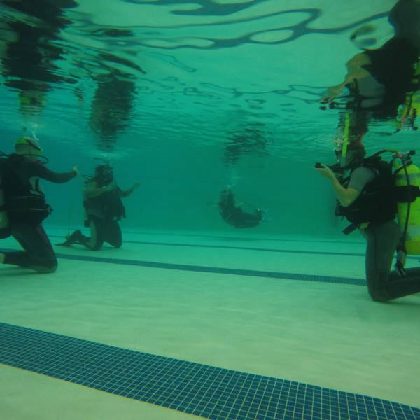 Learning to dive SCUBA pool session first time underwater